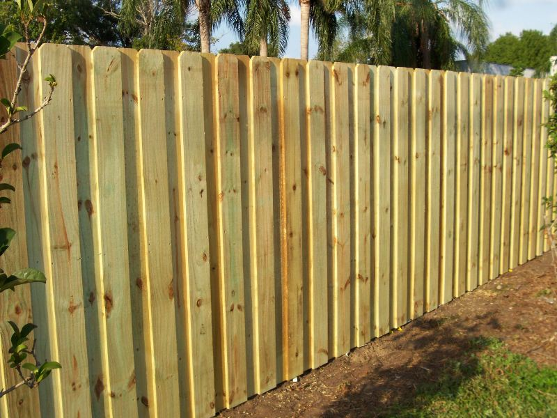 how to fix gap at bottom of wooden fence